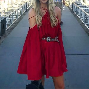 Red cold shoulder flounce dress by Winona